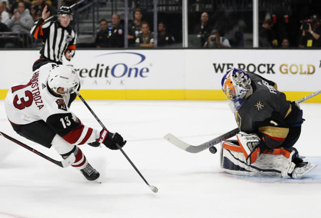 Arizona Coyotes center Vinnie Hinostroza attempts a shot on Vegas Golden Knights goalie Dylan Ferguson during the first period of an NHL hockey game Sunday, Sept. 16, 2018, in Las Vegas. (AP Photo/John Locher)