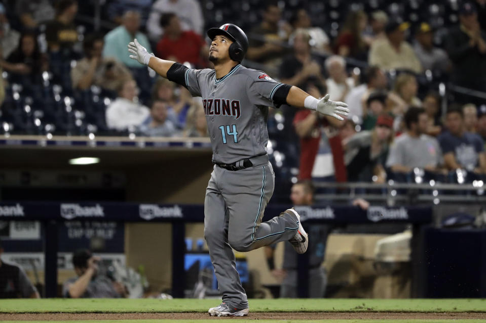 Arizona Diamondbacks' Eduardo Escobar reacts after hitting a home run during the eighth inning against the San Diego Padres in a baseball game Friday, Aug. 17, 2018, in San Diego. (AP Photo/Gregory Bull)