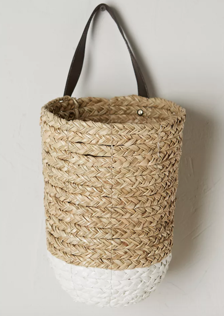 """<h2>Take Advantage Of Your Wall Space</h2><br>It's easy to overlook the potential of a blank and boring wall, but using this space as vertical storage can be smart and stylish. This woven basket will bring a touch of decor to your wall while doubling as a space to hide the essentials from your closet that you need to be able to access easily. <br><br><strong>Anthropologie</strong> Braided Hanging Basket, $, available at <a href=""""https://go.skimresources.com/?id=30283X879131&url=https%3A%2F%2Fwww.anthropologie.com%2Fshop%2Fbraided-hanging-basket%3F"""" rel=""""nofollow noopener"""" target=""""_blank"""" data-ylk=""""slk:Anthropologie"""" class=""""link rapid-noclick-resp"""">Anthropologie</a>"""