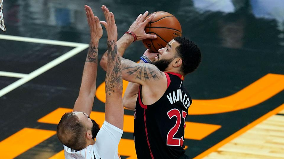 Seen here, Toronto's Fred VanVleet takes the ball to the basket against Orlando.