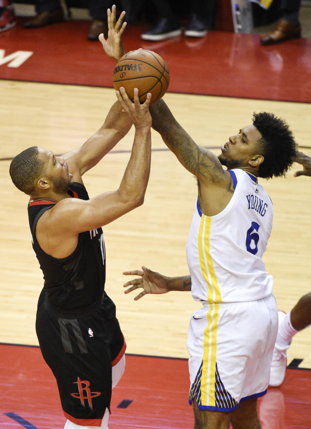 Houston Rockets guard Eric Gordon, left, shoots as Golden State Warriors guard Nick Young defends during the second half of Game 2 of the NBA basketball playoffs Western Conference finals Wednesday, May 16, 2018, in Houston. (AP Photo/Eric Christian Smith)