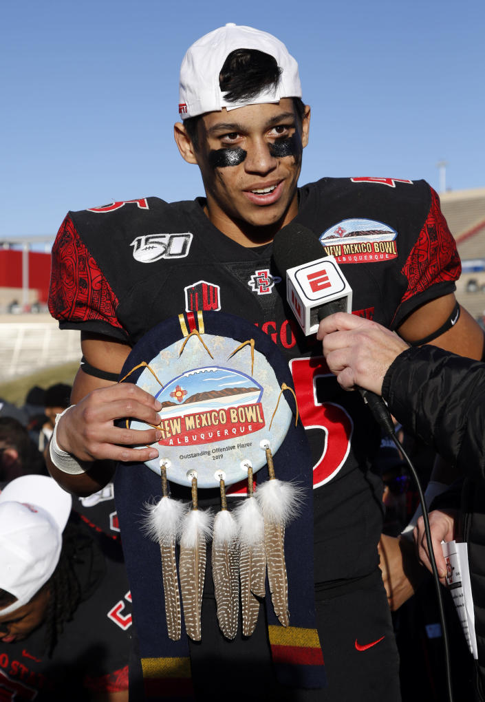 San Diego State wide receiver Jesse Matthews, one of the two recipients of the offensive MVP award, speaks during the presentation of the New Mexico Bowl NCAA college football game on Saturday, Dec. 21, 2019 in Albuquerque, N.M. San Diego State beat Central Michigan 48-11. (AP Photo/Andres Leighton)