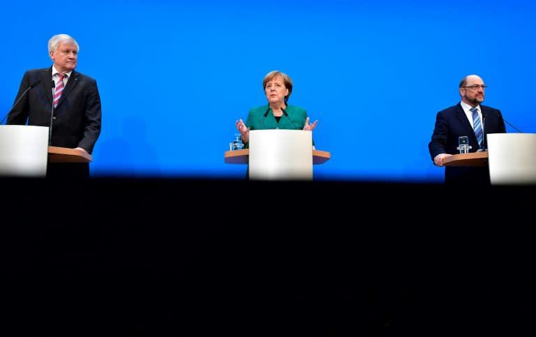 CSU leader Horst Seehofer, Chancellor Angela Merkel and SPD chief Martin Schulz sealed a deal after months of wrangling
