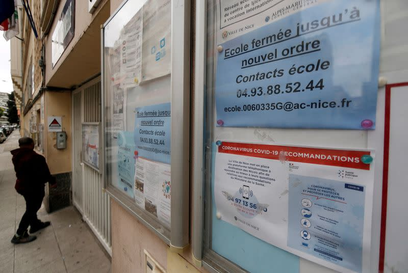 FILE PHOTO: An information sign about the closure of a school due to the coronavirus disease (COVID-19) is seen in Nice