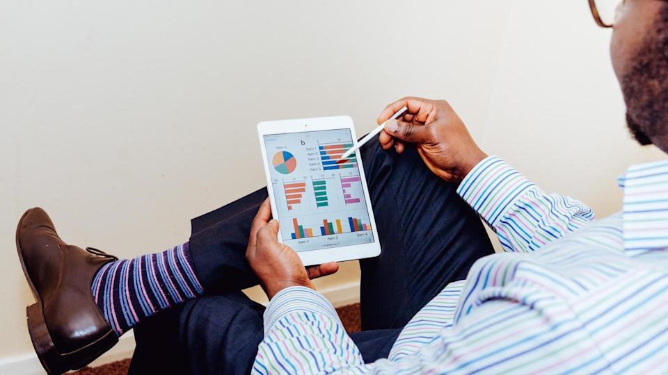 Man reviewing portfolio assets on a tablet