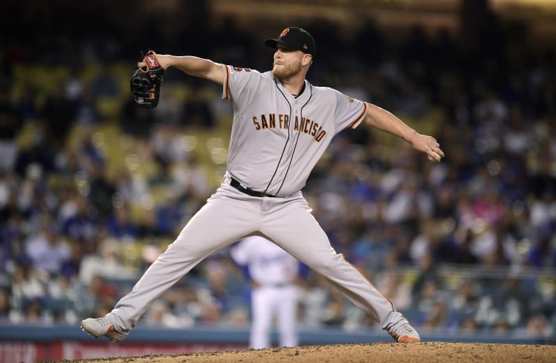 San Francisco Giants relief pitcher Will Smith throws to the plate during the ninth inning of a baseball game against the Los Angeles Dodgers, Monday, June 17, 2019, in Los Angeles. (AP Photo/Mark J. Terrill)