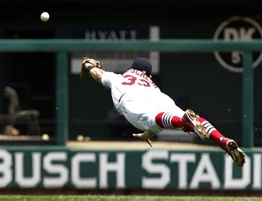St. Louis Cardinals second baseman Daniel Descalso dives but cannot reach a ball hit for a single by Kansas City Royals' Mike Moustakas during the second inning of a baseball game, Sunday, June 17, 2012, in St. Louis. (AP Photo/Jeff Roberson)