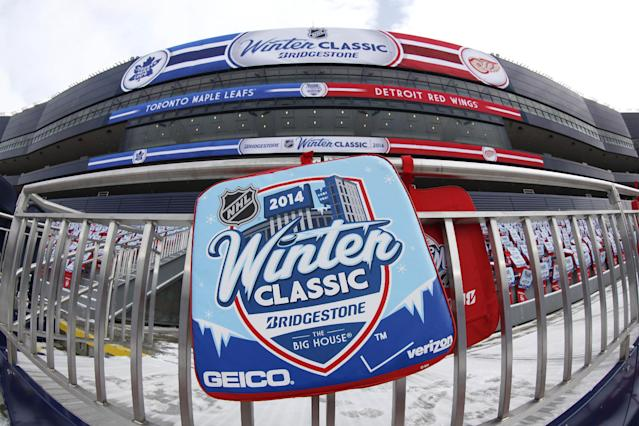 In this image taken with a fisheye lens, an NHL Winter Classic hockey game seat pad is displayed at Michigan Stadium in preparation for the outdoor hockey game between the Detroit Red Wings and Tornto Maple Leafs Tuesday, Dec. 31, 2013, in Ann Arbor, Mich. The game is scheduled for New Year's Day. (AP Photo/Paul Sancya)