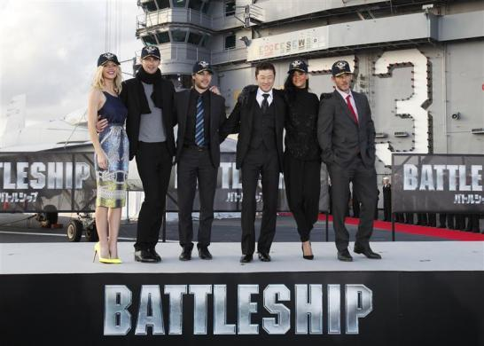 "Cast members of the film ""Battleship"", (from L-R) Brooklyn Decker, Alexander Skarsgard, Taylor Kitsch, Tadanobu Asano, Rihanna and director Peter Berg pose during a news conference atop a flight deck of aircraft carrier USS George Washington at Yokosuka port, south of Tokyo April 2, 2012."
