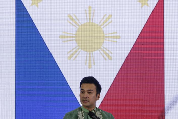"""Representative Lord Allan Velasco speaks after being sworn in as the new house speaker by supporters at the Celebrity sports club in Quezon city, Philippines on Monday, Oct. 12, 2020. A large faction of Philippine legislators in the House of Representatives elected Velasco Monday but the incumbent speaker declared the vote """"a travesty"""" in a tense political standoff between two allies of the president. (AP Photo/Aaron Favila)"""