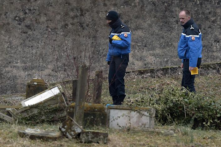 French police investigate defaced tombstones at the Jewish cemetery of Sarre-Union, northeastern France, on February 16, 2015 (AFP Photo/Frederick Florin)