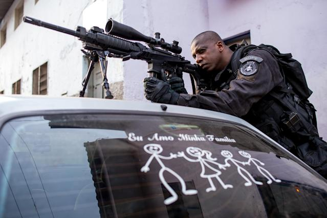 RIO DE JANEIRO, BRAZIL - MARCH 30: A Brazilian military police patrol after entering the unpacified Complexo da Mare, one of the largest 'favela' complexes in Rio, on March 30, 2014 in Rio de Janeiro, Brazil. The Brazilian government has deployed federal forces to occupy the group of violence-plagued slums ahead of the June 12 start of the 2014 FIFA World Cup. The group of 16 communities house around 130,000 residents and have been dominated by drug gangs and militias. Mare is located close to Rio's international airport and has been mentioned as a likely pacification target for the police amid the city's efforts to improve security ahead of the 2014 FIFA World Cup and Rio 2016 Olympic Games. (Photo by Buda Mendes/Getty Images)