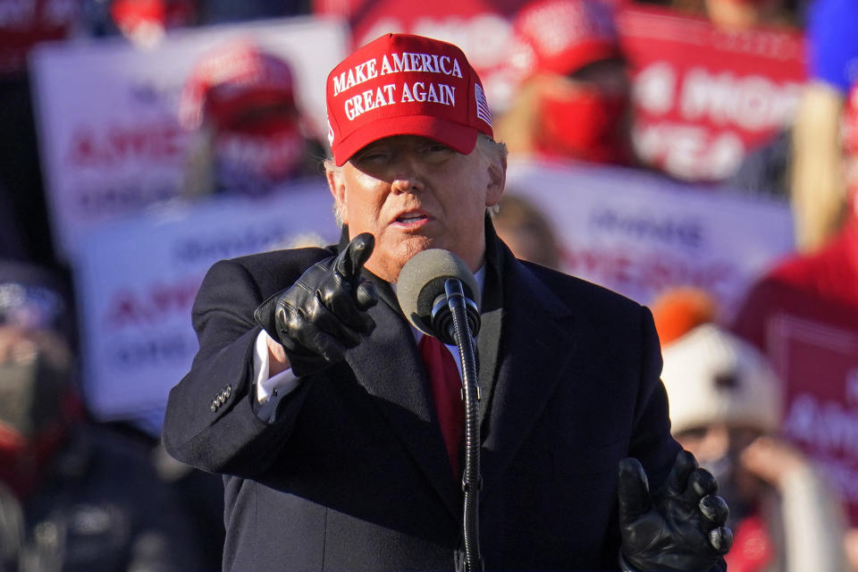 President Donald Trump gestures while addressing a campaign rally at the Wilkes-Barre Scranton International Airport in Avoca, Pa, Monday, Nov. 2, 2020. (AP Photo/Gene J. Puskar)