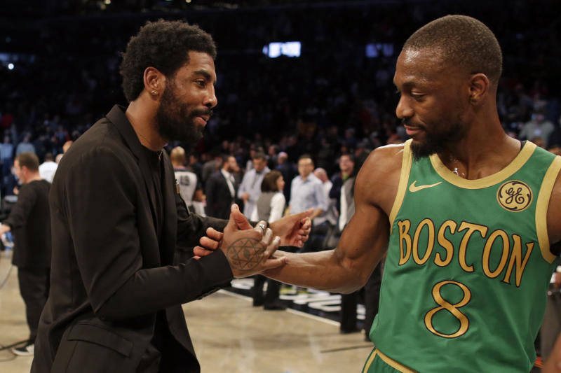 Brooklyn Nets guard Kyrie Irving greets Boston Celtics guard Kemba Walker (8) after their NBA basketball game Friday, Nov. 29, 2019, in New York. The Nets won 112-107. (AP Photo/Adam Hunger)