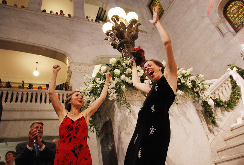 Margaret Miles, right, celebrates with wife Cathy ten Broeke, left, after they were married at the Minneapolis Freedom to Marry Celebration and Weddings, Thursday, Aug. 1, 2013 at the Minneapolis City Hall. The couple were the first women legally married in Minnesota. (AP Photo/Stacy Bengs)