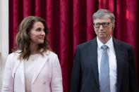 FILE PHOTO: Philanthropist and co-founder of Microsoft, Bill Gates and his wife Melinda listen to the speech by French President Francois Hollande, prior to being awarded Commanders of the Legion of Honor at the Elysee Palace in Paris