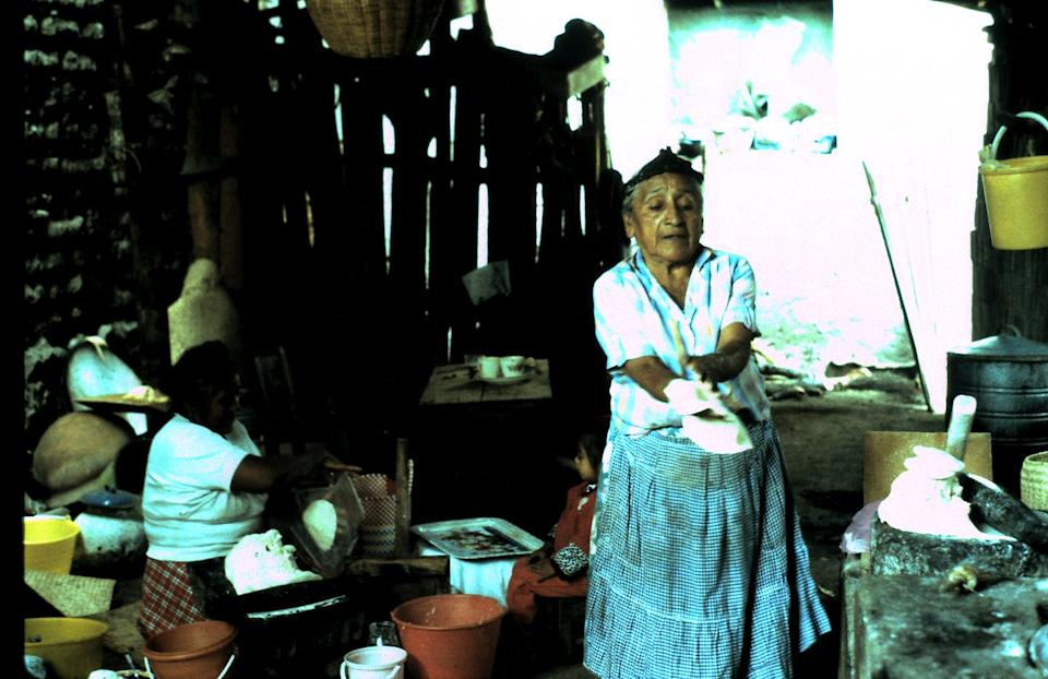 """<span class=""""caption"""">A Zapotec woman making tamales using locally grown maiz, or corn.</span> <span class=""""attribution""""><span class=""""source"""">Jeffrey H. Cohen</span>, <a class=""""link rapid-noclick-resp"""" href=""""http://creativecommons.org/licenses/by/4.0/"""" rel=""""nofollow noopener"""" target=""""_blank"""" data-ylk=""""slk:CC BY"""">CC BY</a></span>"""