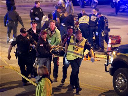 A patient who was struck by a vehicle on Red River Street during the SXSW festival is carried away in downtown Austin