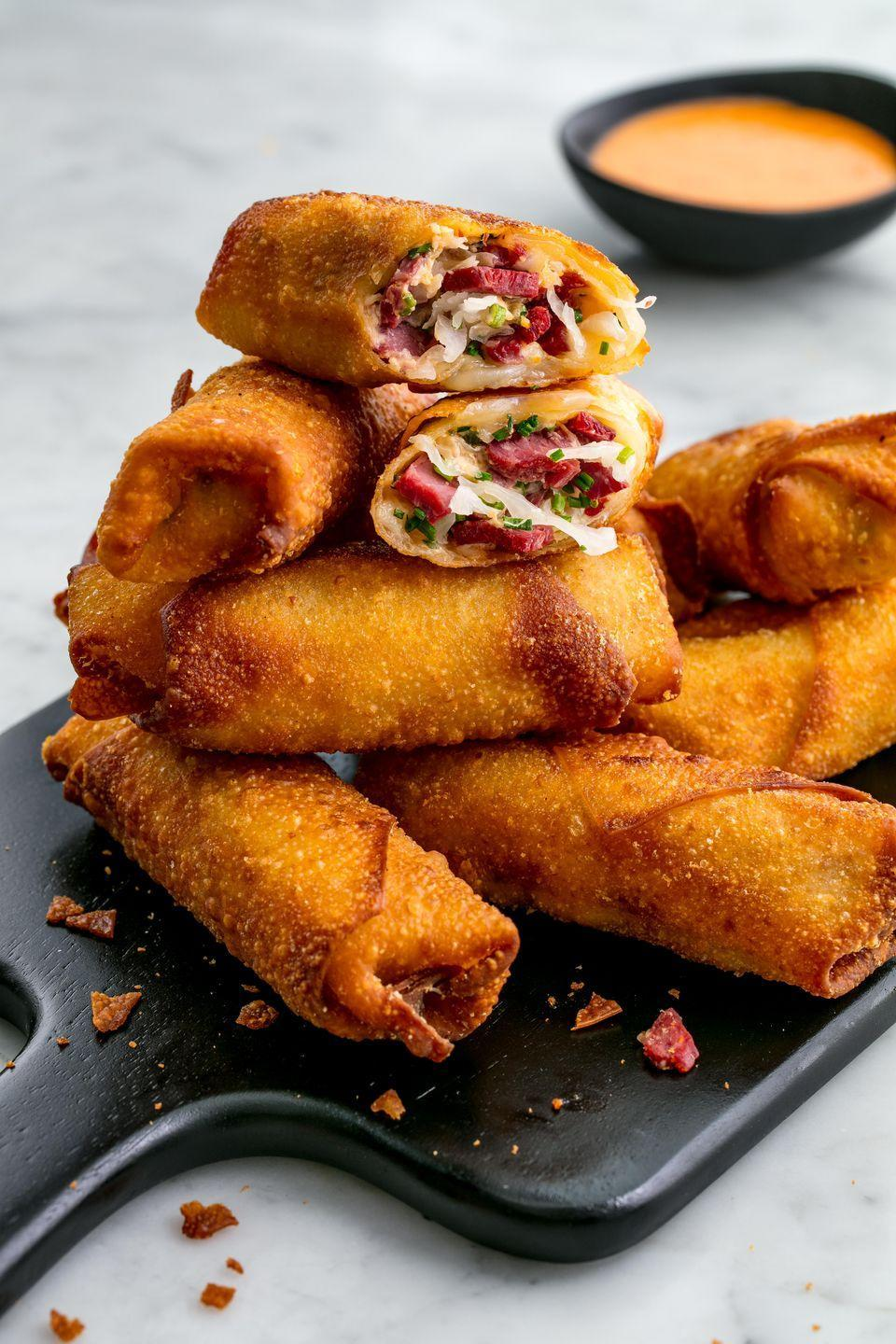 "<p>You've never had an egg roll like this before.</p><p>Get the recipe from <a href=""https://www.delish.com/cooking/recipe-ideas/a22988448/reuben-egg-rolls-recipe/"" rel=""nofollow noopener"" target=""_blank"" data-ylk=""slk:Delish"" class=""link rapid-noclick-resp"">Delish</a>.</p>"