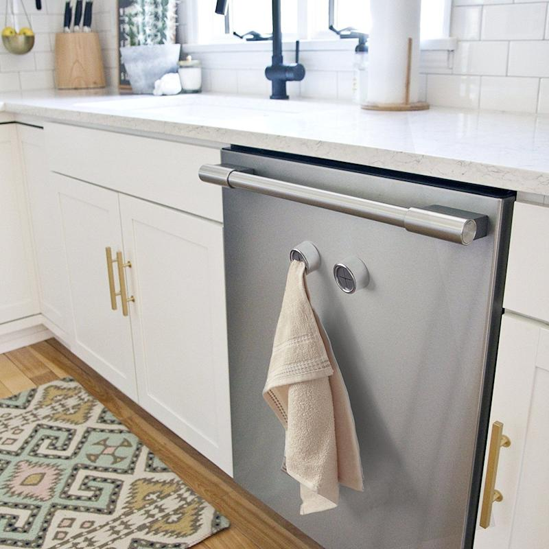 "Looking for an easy way to store towels within reach, without drilling into your backsplash or draping it over the cabinet handle? <a href=""https://www.amazon.com/Kitchen-Towel-Hooks-Adhesive-Installation/dp/B01M0ATHV4/"" target=""_blank"">These adhesive towel hooks are a renter-friendly solution</a>."