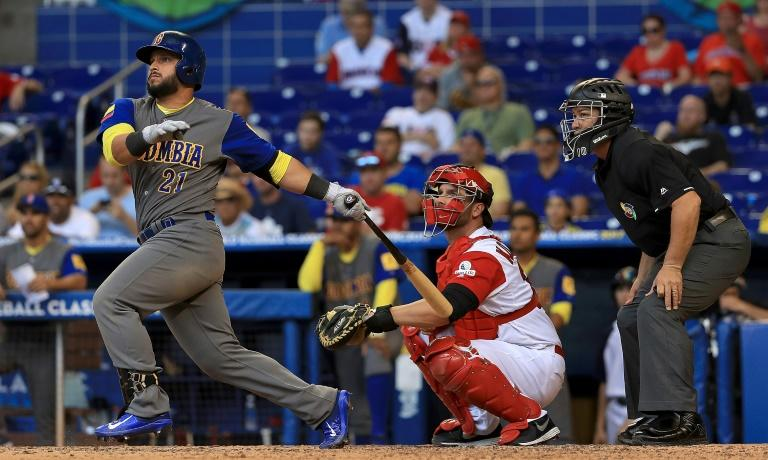 Jhonatan Solano of Colombia hits a double during the ninth inning against Canada on the way to a 4-1 win in the World Baseball Classic