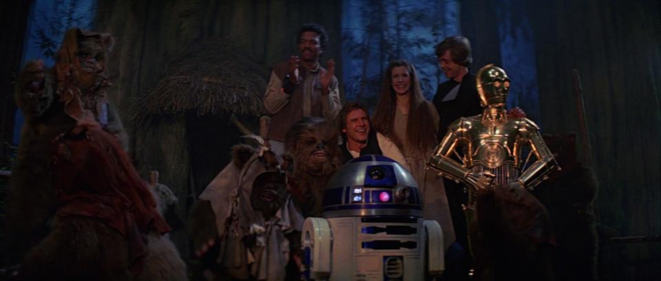 The gang celebrates at the end of the final Star Wars film ever made, Return Of The Jedi (credit: Disney)