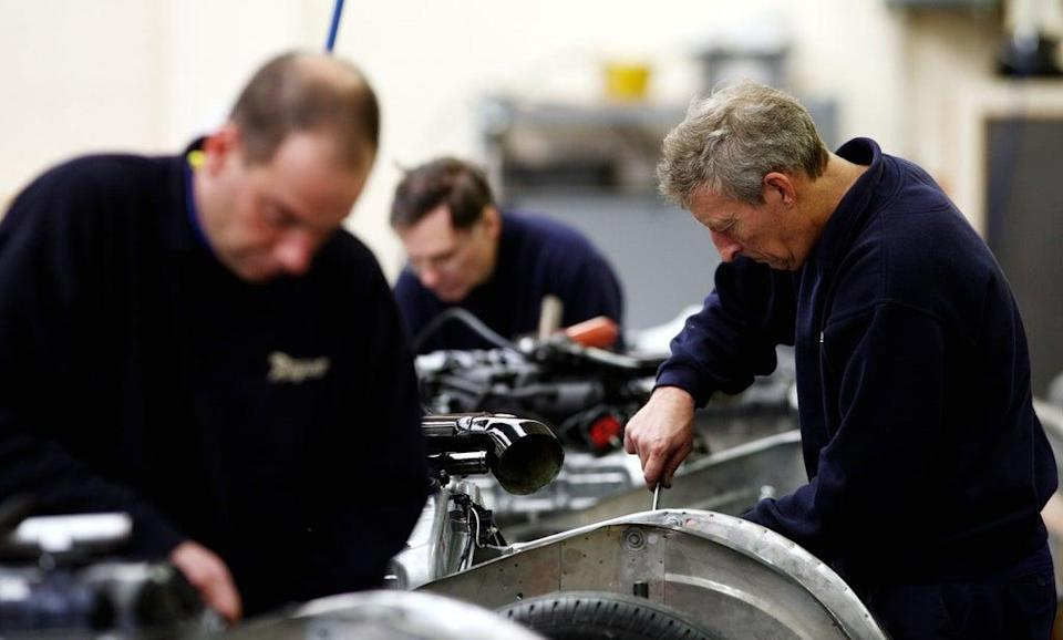 UK factories have seen order books swell to a record high this month but output growth slowed sharply, according to a survey (PA) (PA Wire)