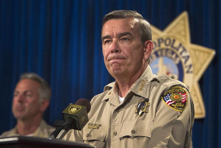 Clark County Sheriff Doug Gillespie takes questions during a news conference at Metro headquarters following the death of two officers and a citizen in Las Vegas June 8, 2014. Two suspects, also dead, shot two Metro Police officers in a pizza shop then fled to a nearby Wal-Mart where they shot and killed another person, police said. REUTERS/Las Vegas Sun/Steve Marcus (UNITED STATES - Tags: CIVIL UNREST CRIME LAW)
