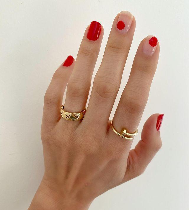 "<p>Bare nails with mismatched scarlet spots are a more abstract way to pay homage to the day of love.</p><p><a href=""https://www.instagram.com/p/B7WyjRmAxP0/"" rel=""nofollow noopener"" target=""_blank"" data-ylk=""slk:See the original post on Instagram"" class=""link rapid-noclick-resp"">See the original post on Instagram</a></p>"