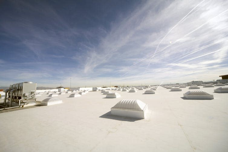 A white roof with skylights under the sky