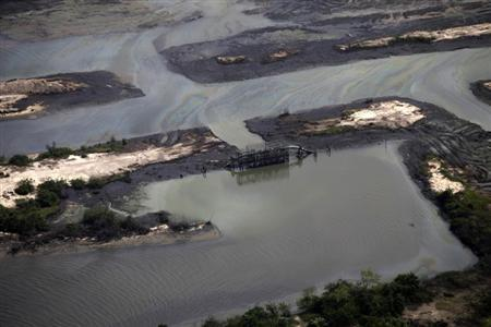 A view is seen of an illegal oil refinery near a flowstation at the Nembe trunk carriage line, during an aerial tour by the Royal Dutch Shell company, near Nigeria's oil hub city of Port Harcourt