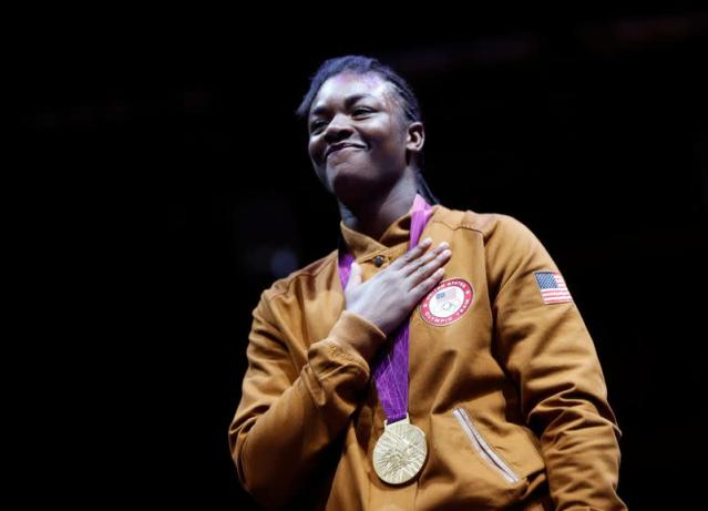 Claressa Shields of the U.S. stands with her gold medal during the presentation ceremony for the Women's Middle (75kg) gold medal boxing match at the London Olympic Games