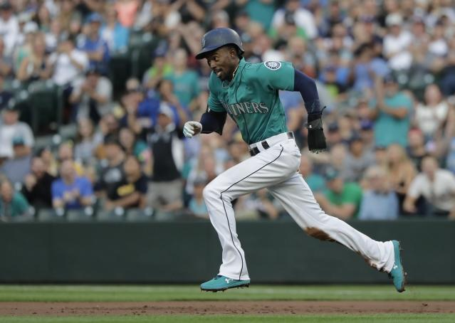 Seattle Mariners' Dee Gordon runs along the basepath during a baseball game against the Chicago White Sox, Friday, July 20, 2018, in Seattle. (AP Photo/Ted S. Warren)