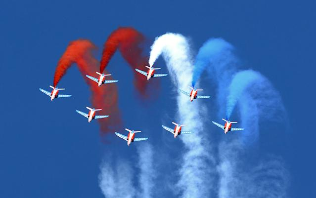 """Alphajet aircrafts from the French elite acrobatic flying team """"Patrouille de France"""" (PAF) perform aerobatics and release trails of blue, white and red smokes representing the French national flag's colors, as they fly over the 701 Air Base in Salon-de-Provence, southern France, on May 25, 2013 during the celebration of the 60th anniversary of the PAF."""