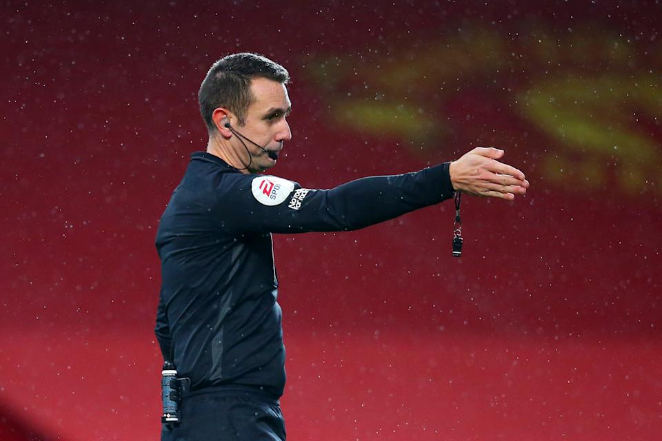 MANCHESTER, ENGLAND - NOVEMBER 21: Referee David Coote points to the penalty spot as he allows Manchester United to retake a penalty, following Sam Johnstone of West Bromwich Albion (not pictured) being off his line for the original penalty kick during the Premier League match between Manchester United and West Bromwich Albion at Old Trafford on November 21, 2020 in Manchester, England. Sporting stadiums around the UK remain under strict restrictions due to the Coronavirus Pandemic as Government social distancing laws prohibit fans inside venues resulting in games being played behind closed doors. (Photo by Alex Livesey/Getty Images)
