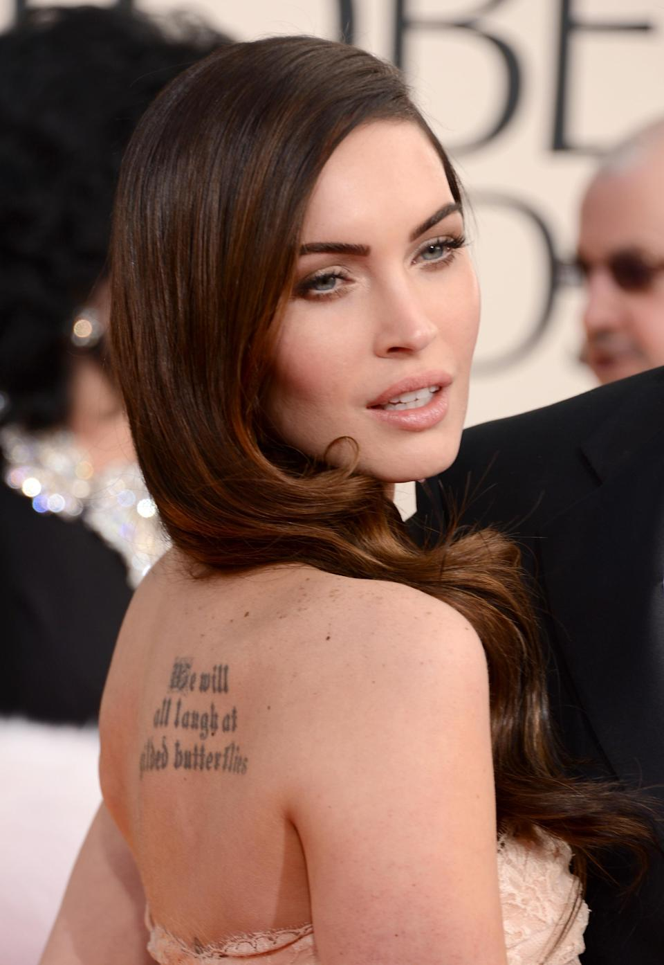 <p>The ink on Megan Fox's right shoulder reads 'We will all laugh at gilded butterflies' and is taken from Shakespeare's play 'King Lear' – although the actress has slightly adjusted the wording. <em>[Photo: Getty]</em> </p>