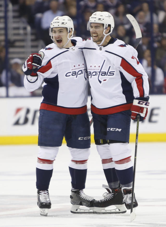 Washington Capitals' Dmitry Orlov, left, of Russia, celebrates his goal against the Columbus Blue Jackets with teammate Matt Niskanen during the first period of Game 6 of an NHL first-round hockey playoff series Monday, April 23, 2018, in Columbus, Ohio. (AP Photo/Jay LaPrete)
