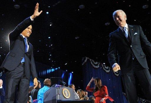 US President Barack Obama and vice president Joe Biden celebrate on the stage on election night in Chicago