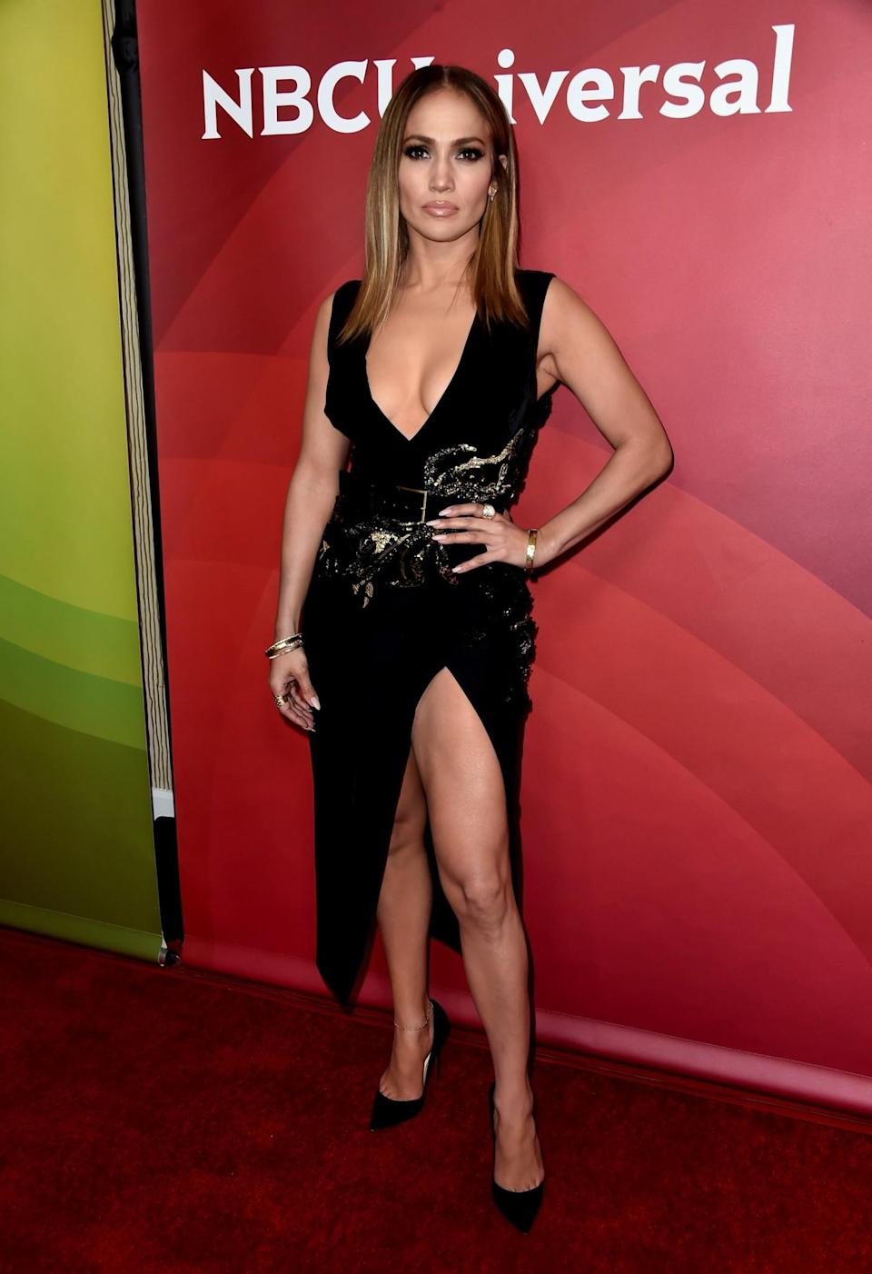 <p>As always, J Lo sizzled in a plunging Elie Saab dress complete with a revealing thigh-high slit.<br><i>[Photo: Getty]</i> </p>