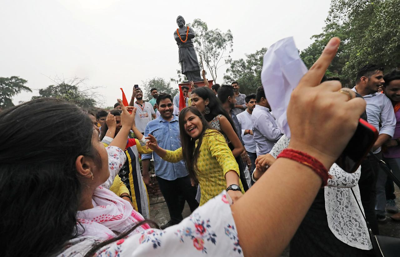 Activists from the Akhil Bharatiya Vidyarthi Parishad (ABVP), the student wing of India's ruling Bharatiya Janata Party (BJP), celebrate after the government scrapped the special status for Kashmir, in New Delhi, India, August 5, 2019. REUTERS/Anushree Fadnavis
