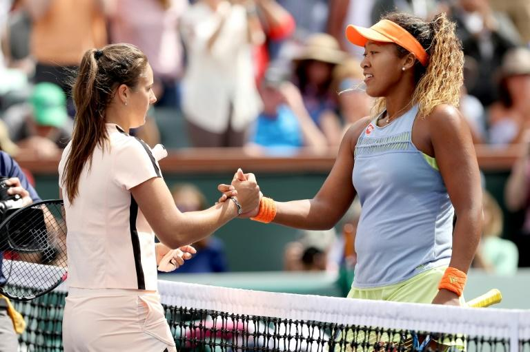 Daria Kasatkina of Russia congratulates Naomi Osaka of Japan after their match