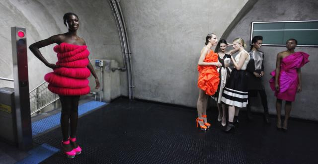 Models present creations in a subway station during Sao Paulo Fashion Week in Sao Paulo October 27, 2013. REUTERS/Paulo Whitaker (BRAZIL - Tags: FASHION TRANSPORT)