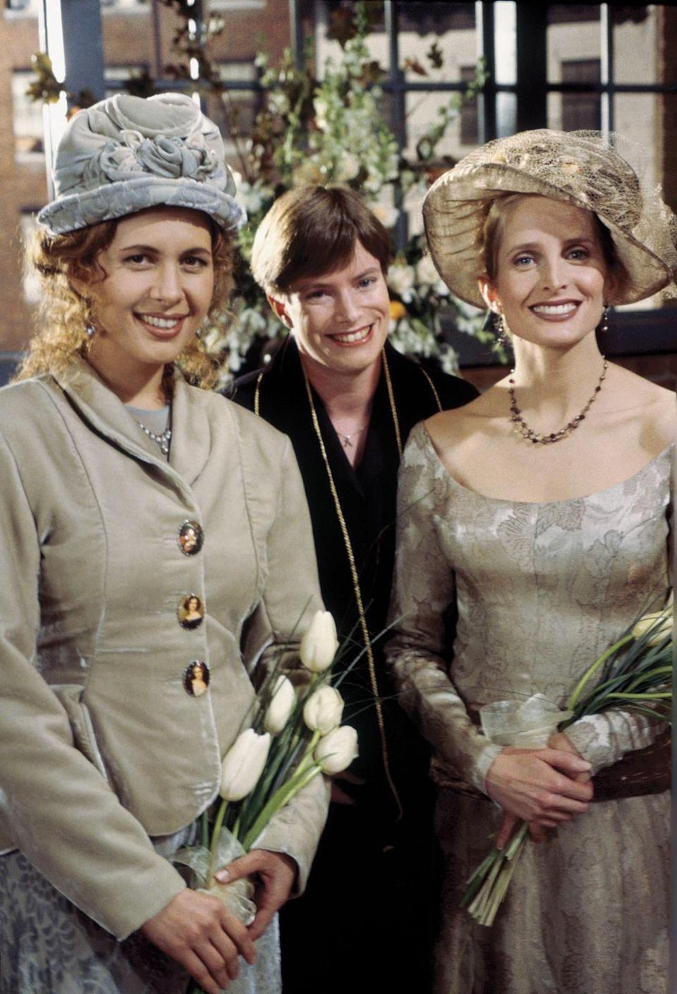 """<p>The first same sex wedding on scripted television appeared on <em>Friends</em>.</p><p>In Season 1, Ross' wife, Carol, leaves him for Susan, whom she weds in Season 2, in an episode unmistakably titled <em>""""The One with the Lesbian Wedding."""" </em></p><p>That same year, President Clinton signed the Defense of Marriage Act (DOMA) into law, denying federal benefits to same-sex couples. In Hawaii, a judge upholds the legality of same sex marriage, per the state's ruling in 1993. In 1998, a vote in the state passed an amendment banning same-sex marriage, overturning the 1993 and 1996 rulings.</p>"""
