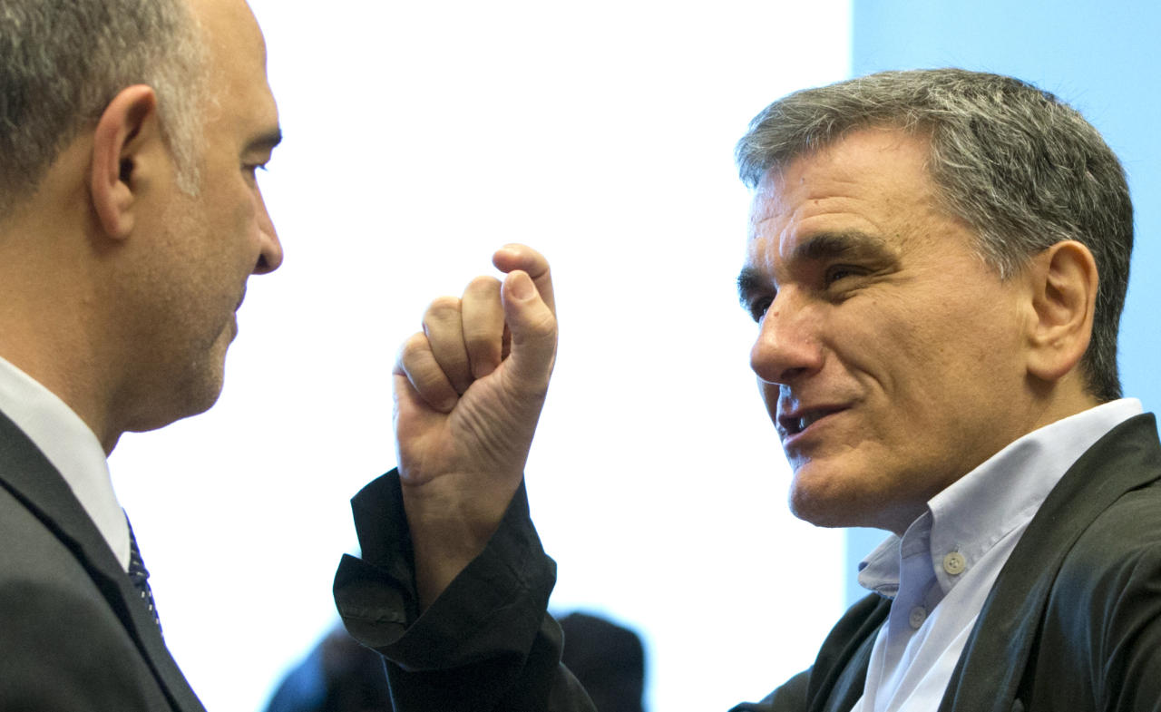 <p> Greek Finance Minister Euclid Tsakalotos, right, speaks with European Commissioner for Economic and Financial Affairs Pierre Moscovici during a meeting of eurogroup finance ministers at EU headquarters in Luxembourg on Thursday, June 21, 2018. Eurozone nations are working on the final elements of a plan to get Greece successfully out of its eight-year bailout program and keep its massive debt burden manageable. (AP Photo/Virginia Mayo) </p>