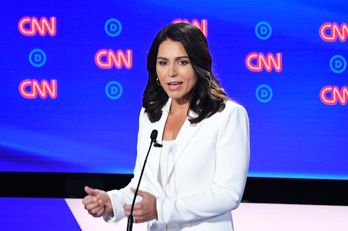Rep. Tulsi Gabbard speaks during the Democratic in Detroit on Wednesday. (Jim Watson/AFP/Getty Images)