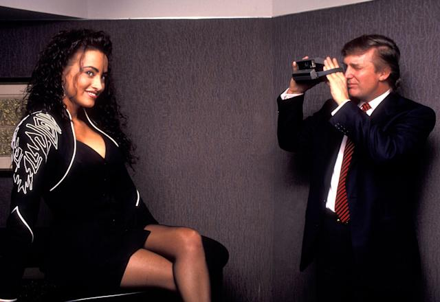 <p>Donald Trump snaps a picture of Playmate hopeful Lisa Madison during a publicity session in New York, May 3, 1993. (Photo: Ron Galella/WireImage/Getty Images) </p>