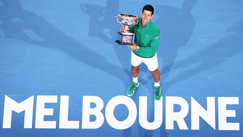 Novak Djokovic with the trophy after winning the Australian Open.