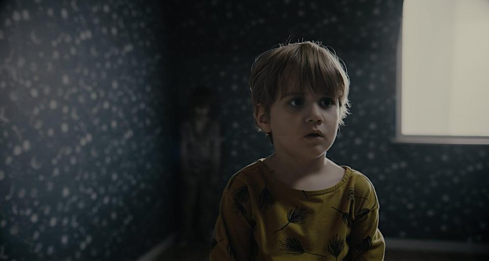 """A 5-year-old (Eddie Eriksson Dominguez) makes a creepy new """"friend"""" in the Swedish horror film """"The Evil Next Door."""""""