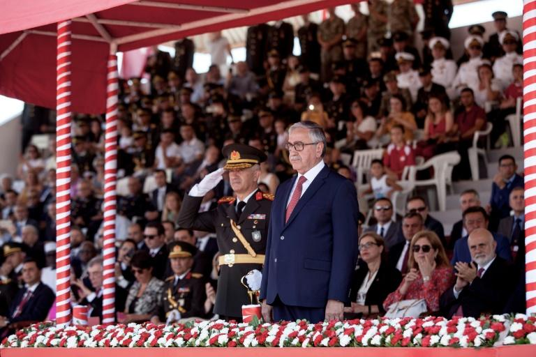 Turkish Cypriot leader Mustafa Akinci attends a military parade in northern Nicosia, capital of breakaway northern Cyprus, on July 20, the 45th anniversary of the Turkish invasion