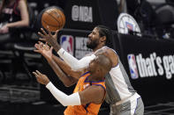 Phoenix Suns guard Chris Paul, left, and Los Angeles Clippers guard Paul George reach for a loose ball during the first half in Game 4 of the NBA basketball Western Conference Finals Saturday, June 26, 2021, in Los Angeles. (AP Photo/Mark J. Terrill)